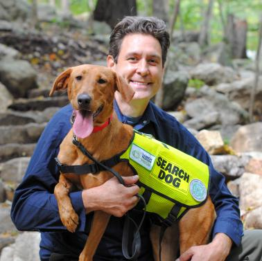 Joshua Beese and Dia the Conservation Detection Dog. Photo by Heather Darley.